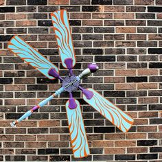 built this dragonfly from parts of a ceiling fan and lots of other found object parts
