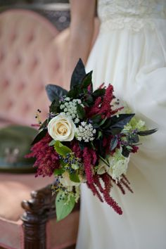 Rustic bride's bouquet. Farm fresh local flowers, foliages and peppers. Masculine/feminine. Eggplant, black, red, burgundy, white, cream, green. Roses, peppers, queen anne's lace, amaranthus, dahlias.