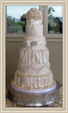 Beautiful wedding cake by B & B Specialty Cakes - Yet again, discovered this while looking for inspirational quotes. ;)
