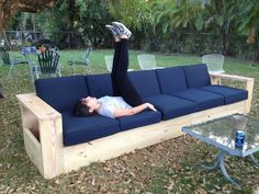 I built a very long outdoor sofa out of wood. First furniture I've ever built DIY Outdoor Sofa - Img Outdoor Furniture Plans, Deck Furniture, Pallet Furniture, Furniture Ideas, Rustic Furniture, Furniture Storage, Antique Furniture, Cheap Furniture, Office Furniture