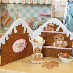 Styled shot of inside of gingerbread house with gingerbread family dolls