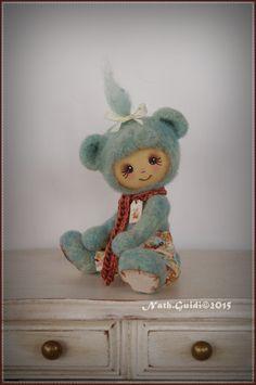 Petit compagnon en laine feutrée au visage peint - nuance turquoise