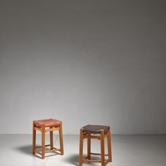 Pair oak stools with leather seatpad, France, 1950s