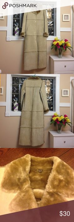 Coat/Vintage Long winter dress coat.  Size Small.  Brandon Thomas. Shell is 100% leather lining is 100% acrylic dry clean only.  Five buttons going down the front. Two pockets. Fake fur on the sleeves and the collar and the lining/inside.  Nice condition. Vintage Jackets & Coats Pea Coats