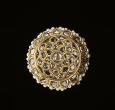 Jewels of India Musée Guimet, Paris | photo: © RMN-Grand Palais / Thierry Ollivier Counterclockwise, from top Buckle, late 18th/19th century. Diamonds, emeralds, gold, gold plate, and...