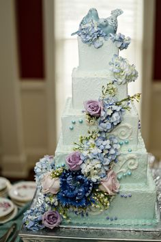 Showstopper ombre mint green to milky sesfoam green buttercream frosting and florals. Realistic cobalt, lavender, sky blue and peach sugar flowers. Vanilla bean cake eith raspberry filling. Enjoy RushWorld boards,  WEDDING CAKES WE DO,  MOOD BUSTERS FEEL BETTER NOW,  EYE CANDY ARCHITECTURAL MASTERPIECES and SPELLBINDING ART INSTALLATIONS.  See you at RushWorld! New content daily.