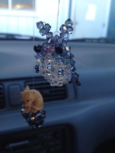 My car charms! Puffed Totoro made from crystals and a puffed heart with a wooden dragondog!