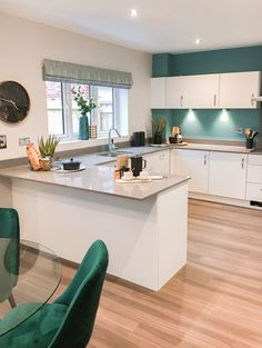Contemporary and modern new build open plan kitchen/diner with white gloss units and pops of teal. Contemporary and modern new build open plan kitchen/diner with white gloss units and pops of teal. Kitchen Cabinet Design, Open Plan Kitchen Dining, Kitchen Plans, Open Plan Kitchen Dining Living, Kitchen Remodel Small, Kitchen Inspiration Design, Kitchen Furniture Design, Open Plan Kitchen Diner, Modern Kitchen Design