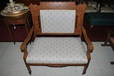 http://www.aardvark-antiques.com/Small-Antique-Carved-Oak-Upholstered-Settee-Bench-p/pa2452.htm