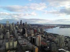 Downtown Seattle shines. Puget Sound. City living breathes energy and excitement into me. Urban dwelling.