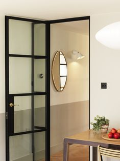 A savvy, design-loving couple set out on a mission to increase the feeling of space and light in the 600-square-foot ground floor of their narrow, contempo