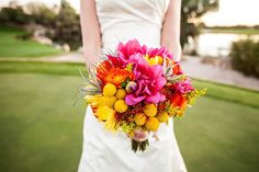real wedding: meant2be events & the boulders resort. What a gorgeous bouquet full of pink dahlias, yellow billy balls, orange mums, and so many fun colors.