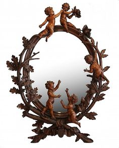 C. 1885 ITALIAN CARVED FRUITWOOD MIRROR, W/ BERRIED OLIVE BRANCHES, ACORN & OAK BRANCHES INTERSPERSED BY FROLICKING PUTTI...