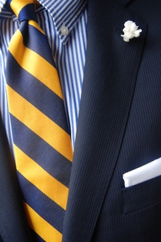 Navy jacket, white shirt with blue candy stripes, blue/yellow repp tie