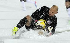 Sliding in: Brad Guzan at least had some fun in the snow, and managed to keep a clean sheet