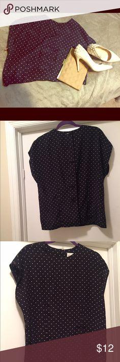 Vintage Blue 💙💙 Vintage blue polka dot short sleeve blouse. Button down back detailing is a winner 😍 Size 14. Tops Blouses