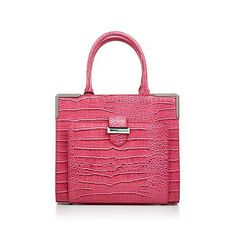 The Snob Essentials' Treasure satchel can make any outfit come to life with its beautiful color, detail, and structure!