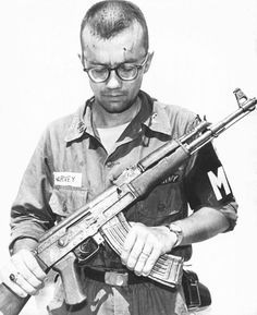 Captain Michael Harvey U.S. Army M.P. inspects an AK-47 Vietnam. Note that the magazine has been incorrectly inserted.