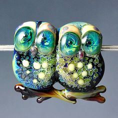 glass owl beads... don't you feel like getting lost in those eyes... :)