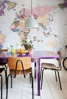 Opting for a pastel colour palette needn't mean you can't mix brighter accent colours in the same room. Take this dining area for instance; the graphic wallpaper mural of a world map in a pastel-heavy palette provides a complementary backdrop for furniture and bits and bobs in brighter variations of the same shades. World class. #refinery29 http://www.refinery29.uk/pastel-interior-design-ideas#slide-7