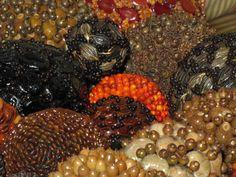 Spheres made of seeds from Guatemala, hand made.  Esferas de semillas hechas a mano de Guatemala.