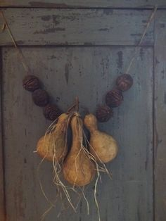 LOVE LOVE LOVE!!!!  The grass (raffia?) adds such a special touch!!!  ---Primitive Black Walnut Gourd Garland Great Early Look | eBay