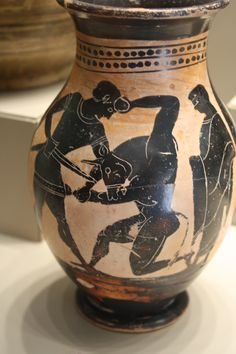 This Attic black figure vase shows Theseus killing the Minotaur of the Cretan labyrinth. A feminine figure looks on from the right, possibly Ariadne. Late 6th BC