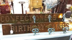 Brass confectioners signs