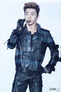 Yongguk stop making your jackets out of duct tape! They make you look to cue...my eyes would melt