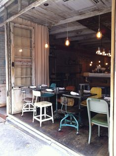 If I saw this cafe I would run to it and never leave.  This is my so style!! Love the different industrial type chairs, too cool!!