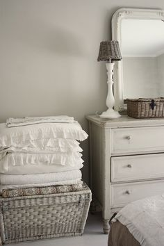White cottage bedroom with shades of grey.  I love the romantic ruffled bedding.