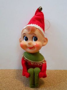I never had a knee hugging elf, but I plan to find one this year and hide him in all the unexpected places which will surprise my husband and buddy of 32 years. Christmas Elf, Christmas Crafts, Christmas Stuff, Vintage Christmas Cards, Vintage Cards, Elf Yourself, Christmas Tree Decorations, Holiday Decor, Doll Japan