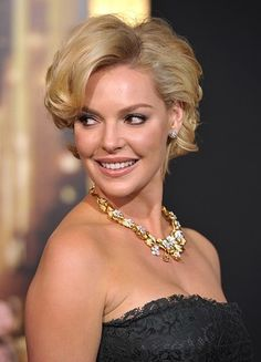 Katherine Heigl pays homage to Marilyn Monroe's signture short golden curled locks.