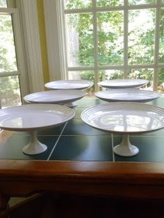 DIY Cake stands from Dollar Tree materials...maybe spray paint the candle stick holders colors to match party?