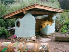 Burnley shelter with beehive cob oven. Seating, shelter and cooking area in one. This is the big winner for my back yard daydream. Bonus: press glass into cob