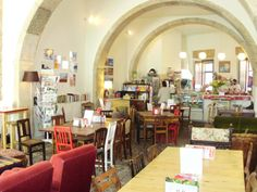 «Pois Café» i always seat on that single yellow sofa behind the table and chairs. with a little table just beside. its a sweet place in Sé