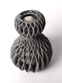 Ceramic Planet Hand carved ceramic sculpture. Free moving interior pieces! One of Celsius Project's sculptural works