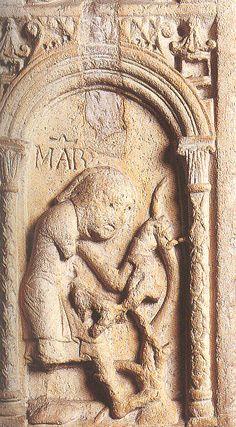 Duomo di Modena, porta della Pescheria. MARZO è un contadino che indossa una doppia tunica ed ha in testa un cappello.   Con una roncola si appresta  a potare la vite.
