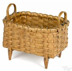 Split oak footed basket, late 19th c., 7 1/2'' h., 8 3/4'' w. Provenance: The Collection of Frank and Sue Watkins, Richmond, Virginia.