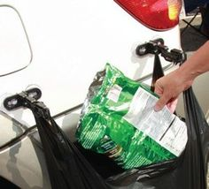 Portable RV trash can.  Plastic arms attach to RV by suction cups.  Can accomodate both plastic grocery bags and large green garbage bags.  Can be mounted inside or outside RV.