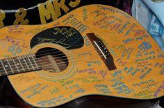 Guest sign a guitar