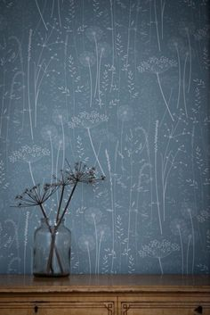 This may be wallpaper, but it's so gorgeous that if you couldn't find it- recreate it with softly hand painting these dandelions and grasses on your own! Watered down white milk paint, would look so beautiful on a muted colored wall...