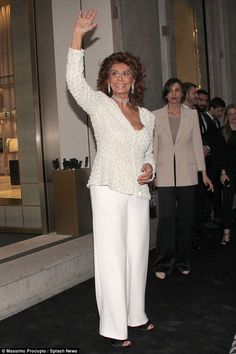 Graceful: Sophia Loren  continued to cement her Hollywood star status  at the Giorgio Armani 40th Anniversary party in Milan, Italy on Wednesday evening