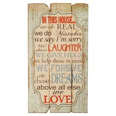 Wood wall decor with a weathered finish and typographic motif.    Product: Wall decorConstruction Material: Wood...
