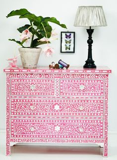Prime and decorative paint a cheap fake wood chest of drawers to disguise it's, well... cheapness. ~BC