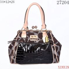 Coach bag with leather accent Like new coach bag with patent leather accents. No marks or noticeable wear. In beautiful condition. Coach Bags