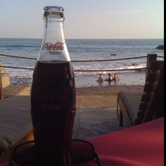 Having a Coke on the beach in El Salvador.