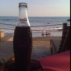 Having a Coke on the beach in El Salvador.