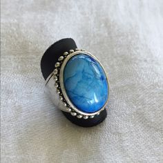 Blue stone intricate ring. Size 7 Intricate stone ring. High quality. Silver-plated. Size 7. Premier Design Quality. Premier Designs Jewelry Rings