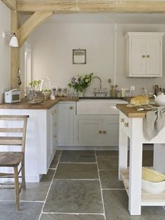 <3 the large tiles and wood counter tops